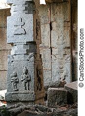 Decorative stone pillar in hampi ruins india