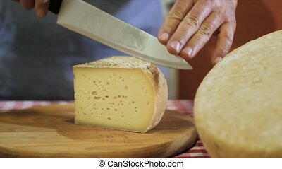cutting italian cheese - traditional italian food, a chef...