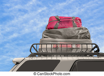 Luggage on van roof rack - Cloth suitcase and duffle bags on...