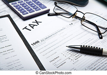 filling tax return on desktop - office work and filling in...