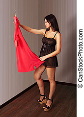 woman look on a red dress
