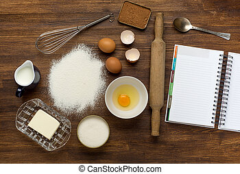 baking background with eggshell and rolling pin.