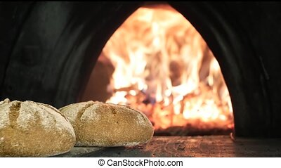 Bread baked in wood oven - baking bread in wood oven