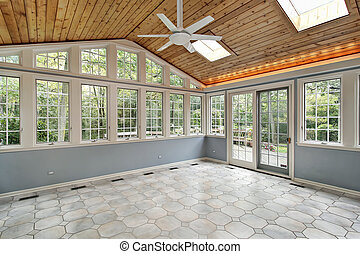 Sunroom with wall of windows - Sunroom in suburban home with...