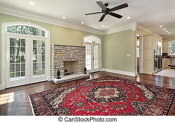 Living room with stone fireplace - Living room in new...