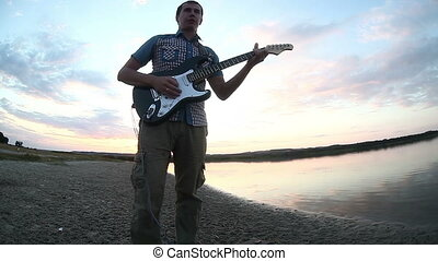 guitarist musician man starts to play the electric guitar...