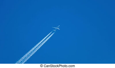 Flying high - Contrails in the blue sky. Airbus 340 flying...