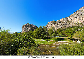 Cliffs of Arco - Trentino Italy - Rock walls with castle in...