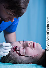 Woman with injured head in emergency room