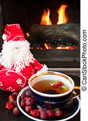 Rosehip tea in front of fire place - Rosehip tea with...