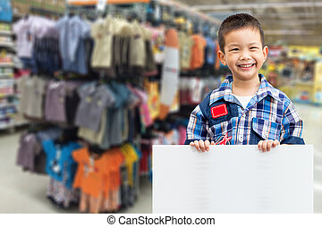 Boy standing and holding empty white board - little asian...