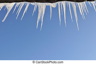 Icicles hanging off the roof - Icicles hanging agains clea...