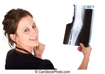 Young female doctor holding an x-ray - Young attractive...
