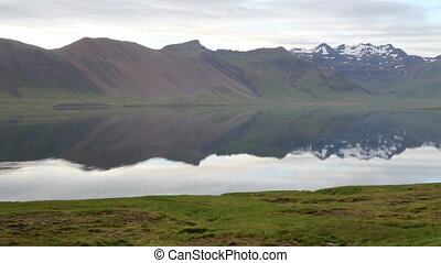 Iceland Lake and snowy mountains La