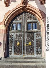 detail of old wooden door of townhall in Frankfurt - detail...