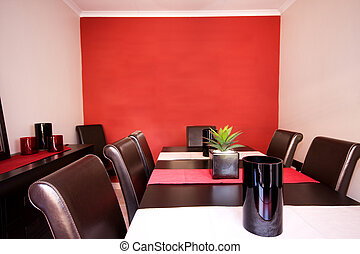 Dining room interior with red wall - Interior view of cozy...