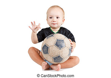 Kid with a soccer ball He is very happy - Little baby is...