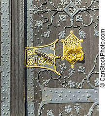 detail of old wooden door of townhall in Frankfurt - detail...