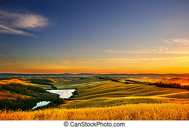 Tuscany, rural landscape on sunset, Italy. Lake and green...