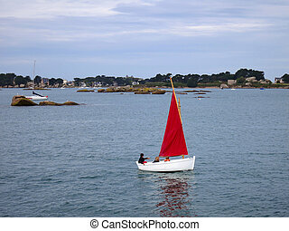White boat with red sail infront of old castle, Brittany,...