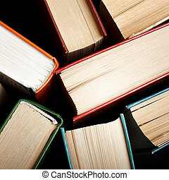 Old and used hardback books or text books seen from above....