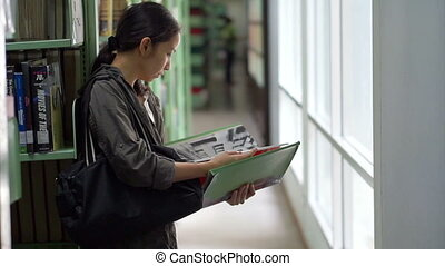 girl student reading books library - Female, girl student...