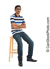 young indian male sitting