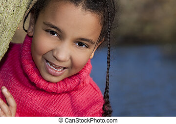 Portrait photograph of a beautiful young smiling happy mixed...