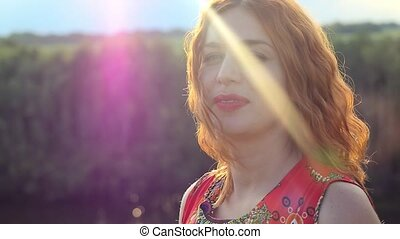 Beauty Sunshine red-haired curly Girl at sunset Dreamy Woman...