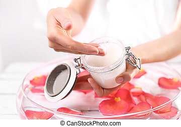 Scrub hands - The woman imposes on hand care cream.