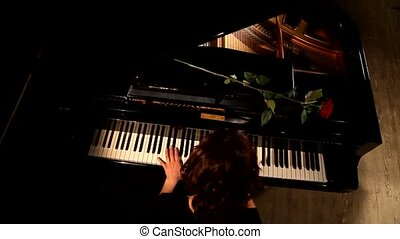 Two hands playing on a beautiful grand piano