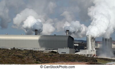 Polluting factory in Iceland with rising white smoke