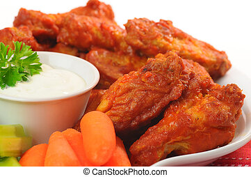 Chicken Wings - Spicy hot buffalo chicken wings shot closeup...