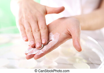 Wellness and spa scrub hands - The woman imposes on hand...