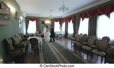 Bride and groom dancing in the beautiful interior - Wedding...
