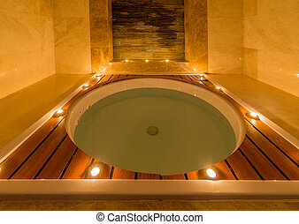Spa room with burning candles