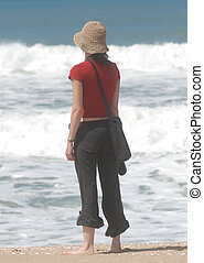 Young woman looking the ocean - Young woman looking to the...