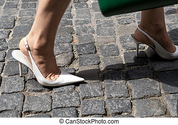 high heels on pavement
