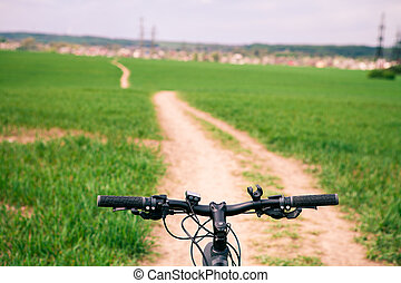 Mountain biking down hill descending fast on bicycle. View...