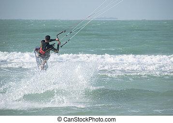 Kitesurfer - A Kitesurfer exhibiting his skills in this...