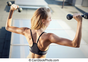 Muscled back, exercises with weight