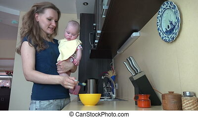 woman feed baby kitchen - Careful woman hold her baby...
