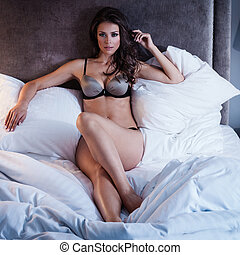 Sexy lingerie - Beautiful lady in sexy lingerie lies in bed