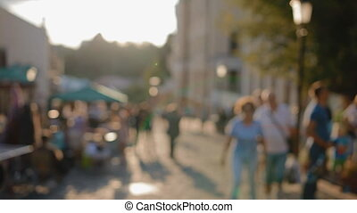 Out of focus scene of crowded street - People walking down...