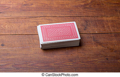 deck of cards on wooden table.