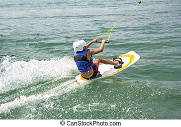 Young Wakeboarder - A young wakeboarder in action on the...