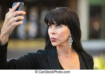 Attractive Woman Taking Selfie - Attractive woman taking...