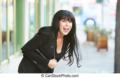 Woman Laughing Outdoors