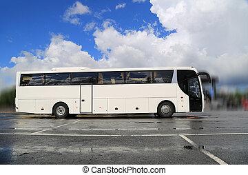 White Coach Bus Waits for Passengers on Foggy Rainy Morning...