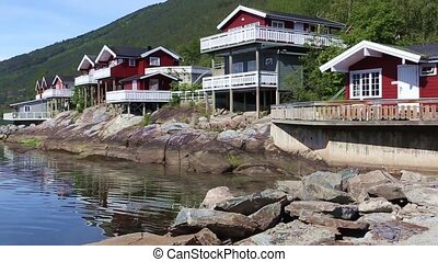 red norwegian houses - red fisherman houses at the fjord...